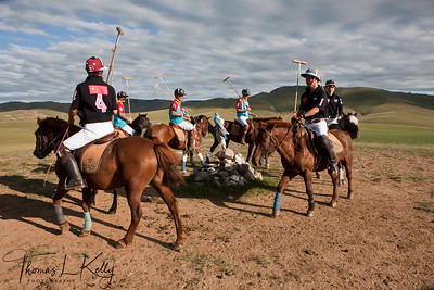 Chinese Polo Team and The Genghis Khan Polo Club members circumambulate Oovo prior to match. Monkhe Tingri, Mongolia