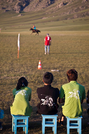 Polo Spectators wear Genghis Khan T-shirt. Monkhe Tingri, Mongolia.