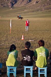 Polo Spectators wear Genghis Khan T-shirt. Monkhe Tingri, Mongolia.