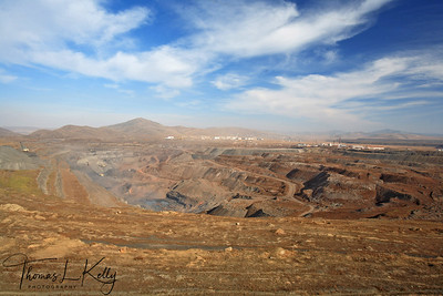 Mongolian-Russian mining venture on the outskirts of the Erdenet city, population of 80,000 dictates work as well as life in the Soviet -style city. 5,200 employees work at this site excavating up to 25.2 million tons of iron ore per year.