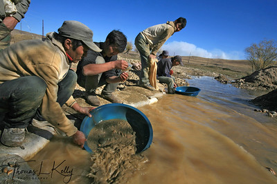 "GOLD RUSH - Ninjas pan for the precious metal in a river in the Sarangol Valley, 200 KMs Northwest of the Capital city Ulan Bator, Mongolia. Ninjas are named for the green pans they wear on their backs that make them resemble the cartoon ""Ninja Turtles"""