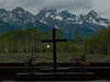 Grand Tetons in the Window, with cross and lightstar