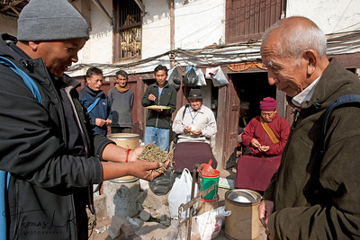 Tibetan amchis from various part of Nepal and India tasting Herb-ingredients at  market  and pharmacy at Itumbahal, Kathmandu, Nepal.