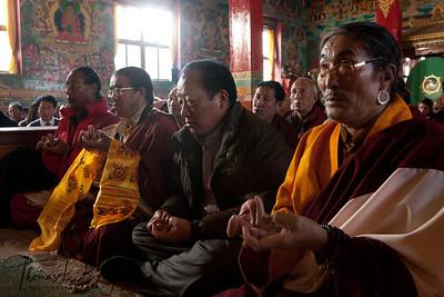 Amchis  (Tibetan Doctors) and monks during Yuthok Nyingthin Lung puja at White Monastery (Seto Gompa).  Boudhanath, Kathmandu, Nepal.