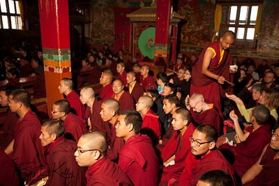 Amchis and monks during Yuthok Nyingthin Lung puja at White Monastery (Seto Gompa).  Boudhanath, Kathmandu, Nepal.