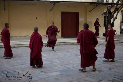 Monks playing Chungi (rubber ball).  Kathmandu, Nepal.