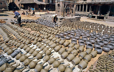 Pottery square .  The caste of potters in Bhaktapur is known as 'Kuma Prajapati'; they live in the Taulachem and Talaco areas.Potting supplements their principle agricultural income and is carried out during lulls in farming activities. Bhaktapur, Nepal.