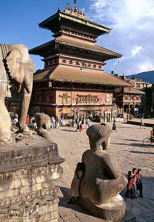 Statue of wrestler guarding Bhaktapur Durbar Square.  Kathmandu, Nepal.
