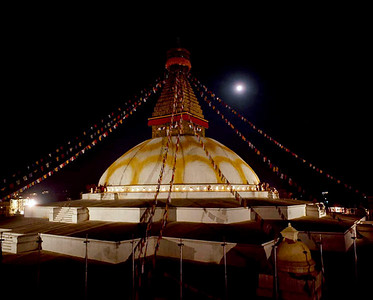 Boudhanath Stupa glowing on a full-moon night. Kathmandu, Nepal.