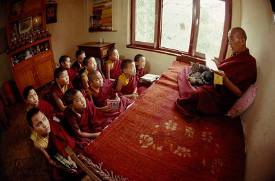 """Buddhist Lama instructs anis (nuns) about Buddhist philosophy.  """" Education is to crack the shell of ignorance, expand the intellect, and thereby encourage the achievement of supreme wisdom, the essence of enlightenment.""""                                                     -Lobsang Lhalungpa, Tibetan Scholar."""