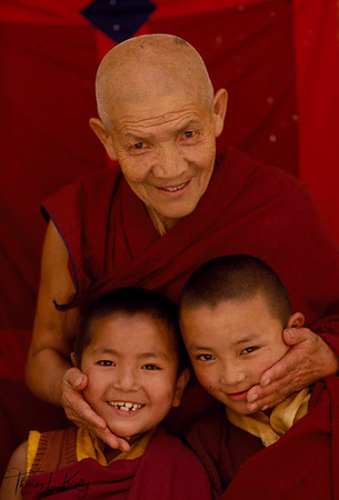 "Ani Tenzin with two young disciples, Swayambhu, Kathmandu Valley, Nepal. ""The Chinese Teach children to believe in only what they see,"" she says, ""We teach our young nuns that there is more o life than what the eye can see."