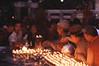 Tibetan pilgrims, monks and nuns lighting butter lamps at the base of Boudhanath Stupa during the Losar festival-Tibetan New Year. Kathmandu, Nepal.