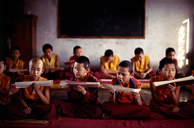 "Young monks chanting scripture.  Mahabuddha Vihara, Monastery, Clementown, India.   "" Education is to crack the shell of ignorance, expand the intellect, and thereby encourage the achievement of supreme wisdom, the essence of enlightenment.""                      -Lobsang Lhalungpa, Tibetan Scholar."