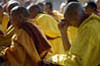 Budhist Lamas in prayer, Bodhgaya, India. Monks attending the Kalachakra Initiation at the Mahaboudhi Temple in Bodhgaya, India. The Mahabodhi Temple marks the site of Buddha's enlightment twenty-five hundred years ago. For centuries Tibetans have made pilgrimages across the Himalayas to sites connected with the life of the historical Buddha. From a Tantric perspective, pilgrimage is more than paying homage at sacred sites. Rather, it is believed that the activities performed at these places become a memory of the place itself. By attuning oneself through ritual and meditation to this timeless presence, similar experiences can be evoked.