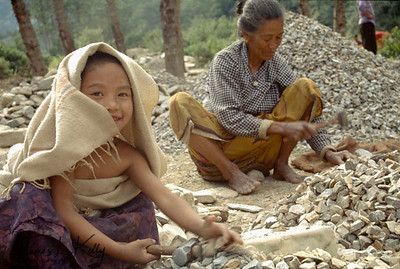 Due to being born to poor parents, these kids are apparently denied to go to school and are bound to follow their parents profession of crushing gravels to suppliment the family income. In Nepal gender inequality is a major problem. Girl is discriminated and rendered to having fullfill all the household chores and not giving a chance to have formal education.  Hetauda, Nepal.