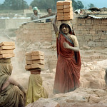 With more than a million people now living in the Kathmandu Valley, the demand housing and office space creates jobs for many local under-age children as well as migrants Bengalis in brick f ...