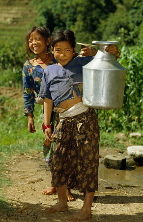 Village Tamang girls pottering water to their home. In Nepal, gender inequality is like a norm. Girl is discriminated and rendered to having to fulfill all the household chores, and not given a chance to have a formal education. Sindupalchowk, Nepal.