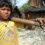 Due to born to poor parents, these kids are apparently denied to go to school and are bound to follow their parents profession of crushing gravels to suppliment the family income. 