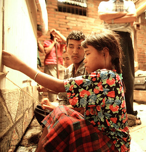 Under aged and exploited young Tamang girls working at carpet factory. Such places are preying grounds for traffickers who abduct or persuade the girls away from factory to big cities like Mumbai, Delhi and Kolkatta. Kathmandu Nepal