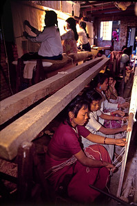 Weaving factory showing young girls between age of 8 to 16. Such places are preying grounds for traffickers who abduct or persuade the girls away from factory to big cities like Mumbai, Delhi and Kolkatta. Kathmandu Nepal
