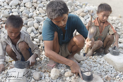 Due to born to poor parents, these kids are apparently denied to go to school and are bound to follow their parents profession of crushing gravels to suppliment the family income.  Hetauda, Nepal.