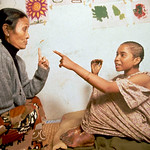 A burnt victim. Street walker in Dillibazar, she was raped and doused with kerosene by one of her clients. She died a week later. To the left is Anuradha Koirala , Director of Maiti Nepal (T ...
