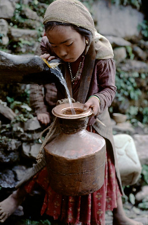 Village Tamang girl pottering water to their home. In Nepal, gender inequality is like a norm. Girl is discriminated and rendered to having to fulfill all the household chores, and not given a chance to have a formal education. Sindupalchowk, Nepal.