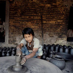 In the strict caste system of Nepal, many sons are relegated to carry out their father�s duty in order to supplement income for their family. School is not an option. This Kumale (pooter ca ...