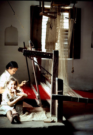 With booming cashmere and pashmina shawl and scarf fashion, many young children  carry out weaving in such factories. Kathmandu, Nepal