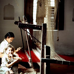With booming cashmere and pashmina shawl and scarf fashion, many young children carry out weaving in such factories.Kathmandu, Nepal