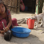 In lots of villages of Nepal; to survive all the members have to contribute labour to make living. This girl is delegated to clean dishes for local tea stalls to supplement family income.