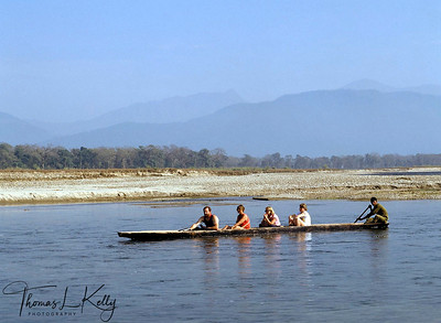 Tourists enjoy boating at Rapti river. Chitwan National Park, Chitwan, Nepal.