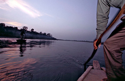 Tharu boatmen on the way back home. Chitwan National Park, Chitwan, Nepal.