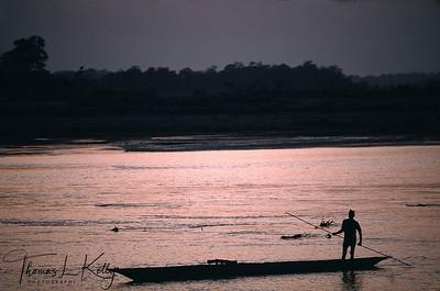 Tharu fisherman sings his sorrow on the way back home. Chitwan National Park, Chitwan, Nepal.