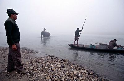 Tourists enjoy boating at Rapti river. Chitwan National Park, Chitwan, Nepal.