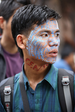 """Protest against Fundamentalist's allegation for Manish Harijan's painting exhibition at Siddhartha Art Gallery """" THE RISE OF THE COLLATERAL"""".  Protesting artist taped their eyes and mouth to connote the supression of freedom of Artist's expression.  Kathmandu, Nepal."""