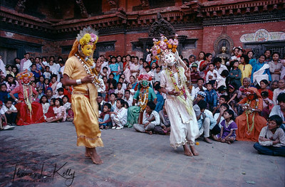 In Patan's Mul Chok during Dashain Navaratri (ninth night) Asta Matrika dancers celebrate the Goddess Durga triumph over the buffalo demon, Mahisasur. Men and boys dressed to represent the mother-earth goddess become possessed with the goddess energy and perform acts showing her powers. The performances were initiated in seventeenth century by the Malla king Srinavasa, whose father built the Krishna temple in Patan. Indrani dances in an orange mask covered with eyes; nobody can hide from the goddess. Maheswari dances in white mask, which represents the female aspect of Shiva, who continually combats demons. Brahmayani, in a yellow mask, represents the human aspect of Brahma, the creator. Kathmandu, Nepal.