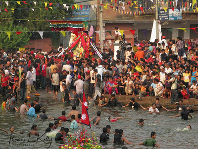 Residents of Handigau pulling he chariot of a local deity into the Gahana Pokhari in Kathmandu on Monday, the 21st of April, 2008 Hadi Gau Jatra, Gahanpokhari, Kathmandu, Nepal