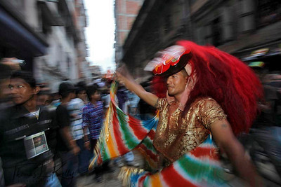 Lakhe dancers lead the procession of Living Goddess Kumari, God Ganesh and Bhairav through the narrow lanes of the southern part called 'kone' of old Kathmandu. Indra Jatra Festival. (Lakhe is a masked dancer)