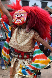 Lakhe dancers lead the procession of Living Goddess Kumari, God Ganesh and Bhairav through the narrow lanes of the southern part called 'kone' of old Kathmandu. Indra Jatra Festival. (Lakhe is a masked dancer)