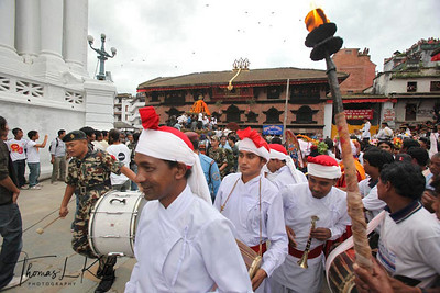 Newar Buddhist priests parade during Indra Jatra (festival) which is celebrated by Newars of Kathmandu two weeks before Dasai, the biggest Hindu festival of Nepal. Kathmandu, Nepal.