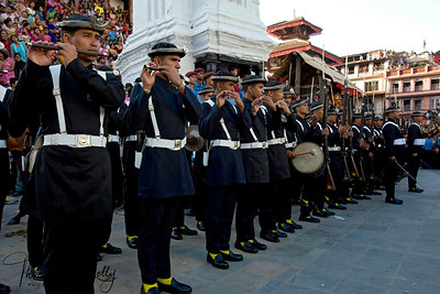 Gorkha soldiers parade through Durbar Square on Indra Jatra. They perform and later give gun salutation to initiate the Jatra or festival.