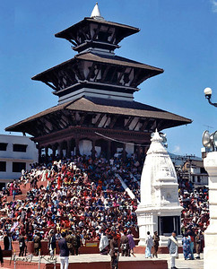 Huge mass of people congregate at Basanta Durbar Square to witness the procession of Kumari and Lakhe dance during Indra Jatra celebration.