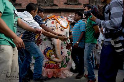 Pulu kishi, the elephant masked dancer along with other lakhe dancers leads the procession of Living Goddess Kumari, God Ganesh and Bhairav through the narrow lanes of the southern part called 'kone' of old Kathmandu. Indra Jatra Festival.