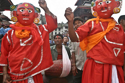 Lakhe dancers lead the procession of Living Goddess Kumari, God Ganesh and Bhairav through the narrow lanes of the southern part called 'kone' of old Kathmandu. Indra Jatra Festival. (seen here are Sava-bhaku masked dancers)