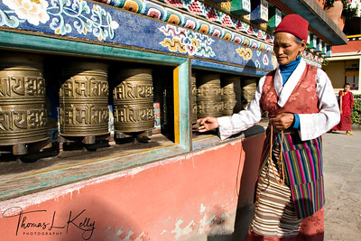 Devotee rotating Mani Wheels. Boudhanath