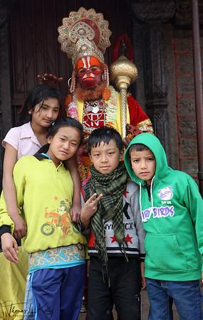 Hanuman blessing kids.  Pashupatinath temple, Kathmandu, Nepal.