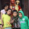 Hanuman blessing kids. <br /> Pashupatinath temple, Kathmandu, Nepal.