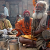 Ektara are commonly used in kirtan chanting by sadhus, which is a Hindu devotional practice of singing the divine names and mantras in an ecstatic call and response format.<br /> Pashupatinath temple, Kathmandu, Nepal.