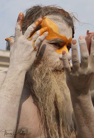 After a sadhu bathes to purify the body, he applies the tilaka while uttering mantras to sanctify his body, thus completing the ritual that transforms the body into a vessel worthy of receiving divine power and giving worship to God. Pashupatinath temple, Kathmandu, Nepal.